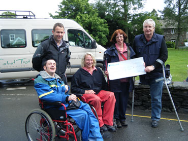 Caroline Nichol presents the cheque to members of The Lake District Calvert Trust