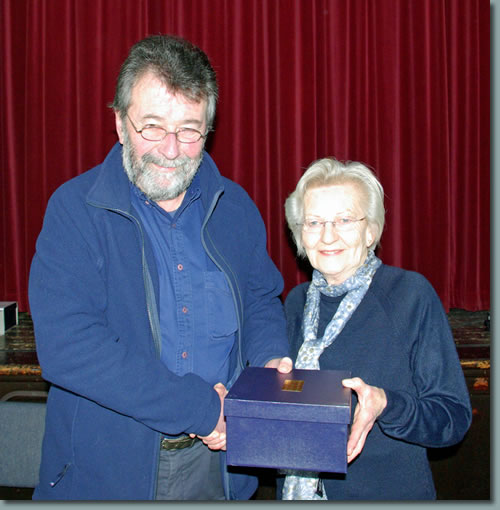 Eric Robson presents Ann Parnham with an inscribed cut-glass bowl in recognition of her many years of 'backroom' service to the Society