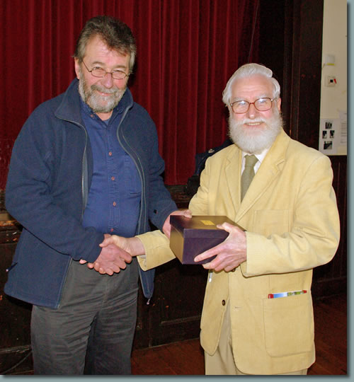 Eric Robson presents Chris Jesty with an inscribed tankard in recognition of his work in revising all of Wainwright's pictorial guidebooks