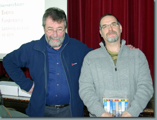 Eric Robson presents a set of Pictorial Guides to Niels Rasmussen for winning the 2013 Photographic Competition