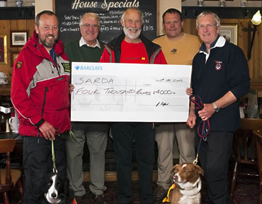 Wainwright Society cheque presentation to SARDA by Chris Bonington