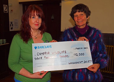 Michelle Waller (left) receives a cheque from Jenny Whalley (right)
