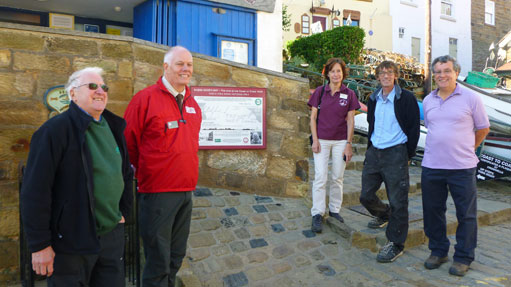The unveiling of the Robin Hoods Bay Information Board